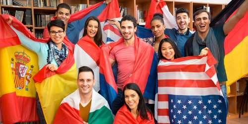 Photo: academic group poses with multinational flags