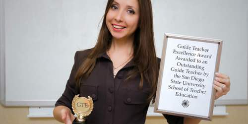 Photo: GTE award winner poses with plaque reading GTE Award awarded to an outstanding guide teacher by the SDSU School of Teacher Education