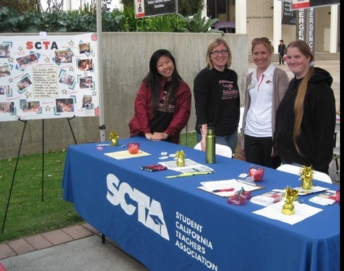 Photo of several SCTA members tabling outdoors on campus