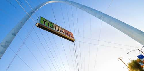 Photo: Suspension bridge with sign that says Tijuana