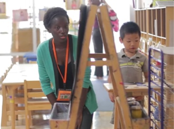 UCSD alumnus and child with easel and art supplies