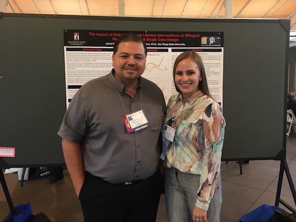 Photo: Jenna Palacios poses with Dr. Gutierrez in front of presentation