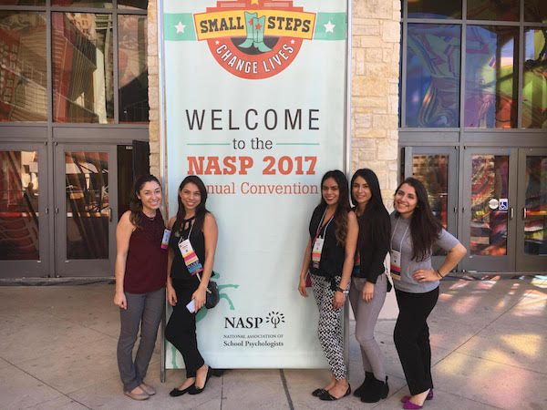 Photo: First year students attend their first NASP convention and pose in front of convention sign