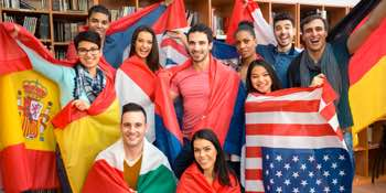 Group of academics pose with multinational flags