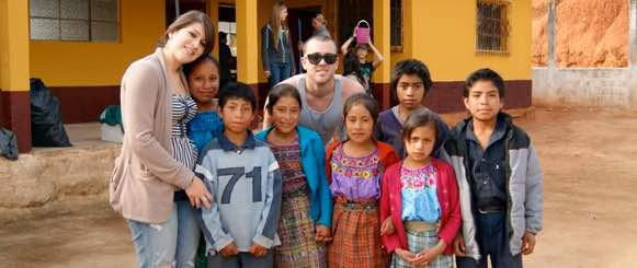 American students pose with children at Guatemala school