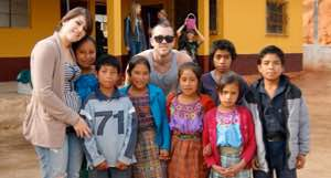 American students pose with children at a Guatemala school
