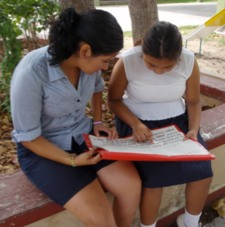 Photo: student and teacher reading together