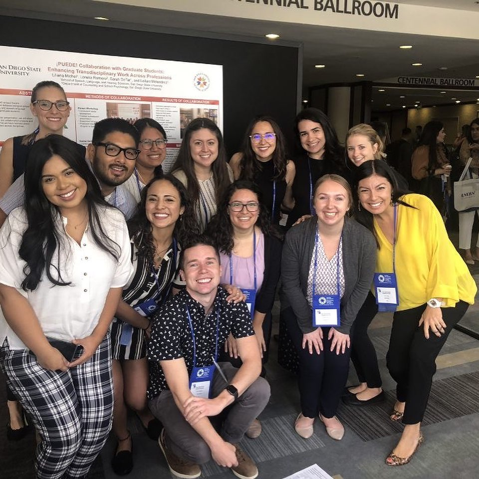 PUEDE scholars pose in front of the poster they presented at the 2019 CASP conference in Long Beach, California.