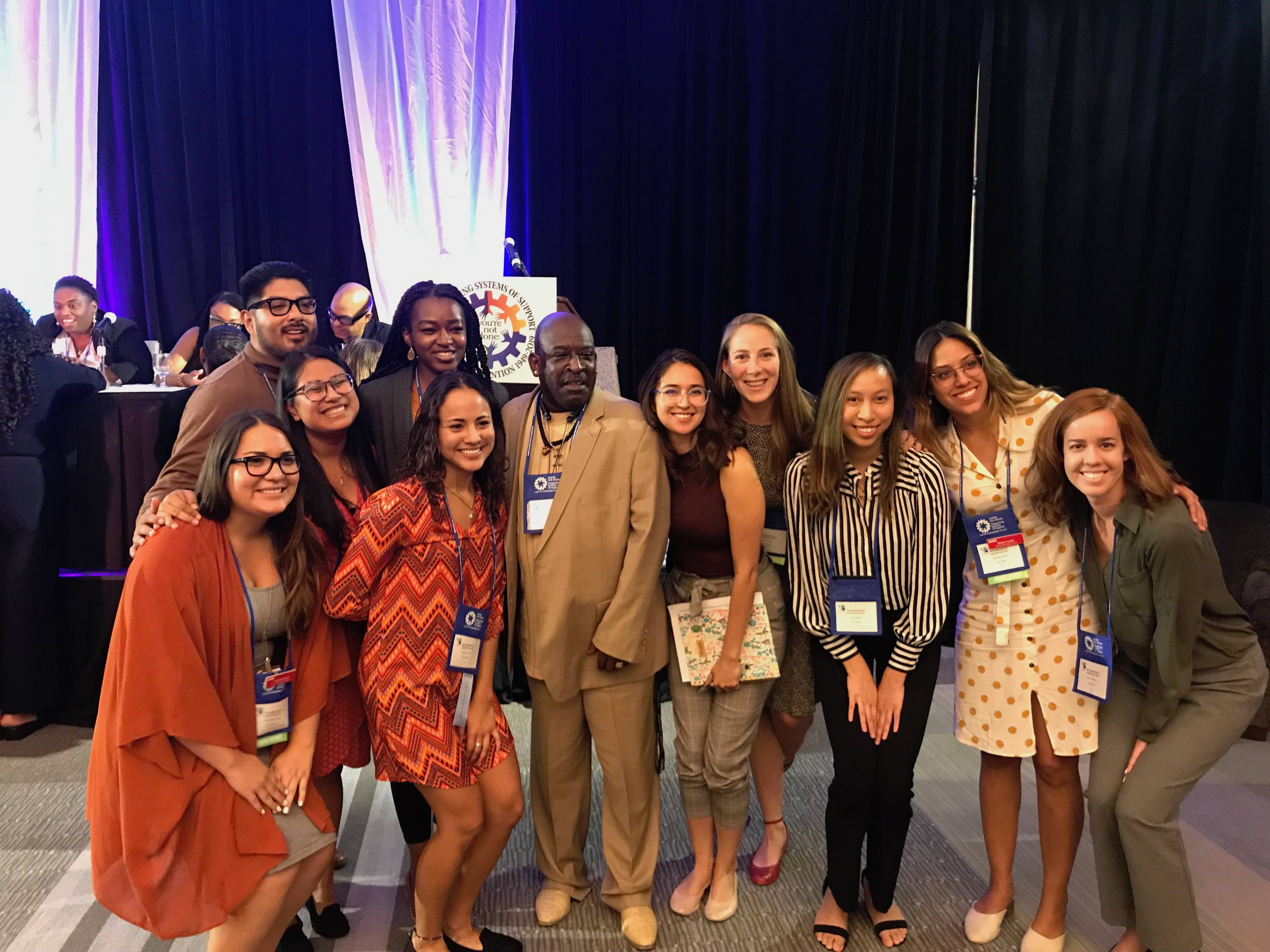 Students smiling with Darryl, the student who was at the center of the Larry P. court case, at the 2019 CASP convention in Long Beach, California.