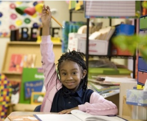 Photo: school girl raising her hand