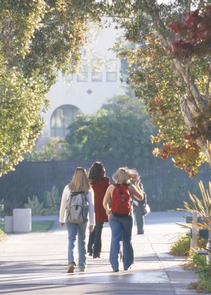 Group of students walking on SDSU campus.