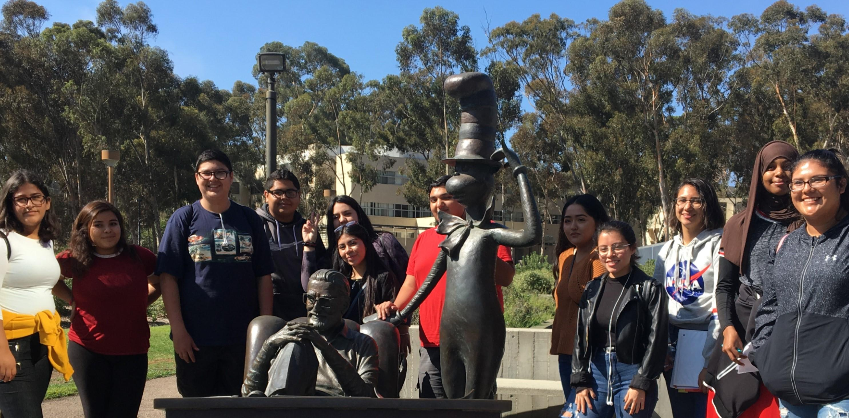 Students at Dr. Seuss statue at UCSD.