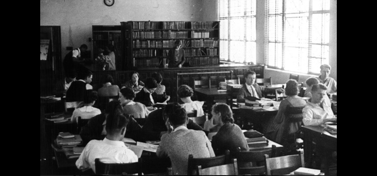 Photo of students in the library studying.