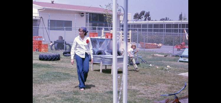 Photo of an instructor and child on a playground.