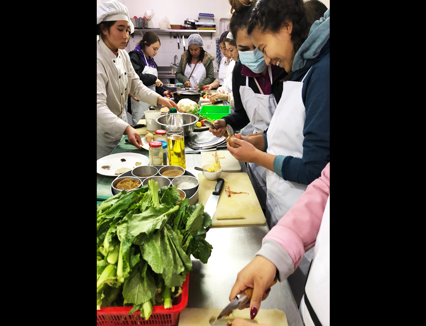 Students participate in a cooking class with local cuisine.