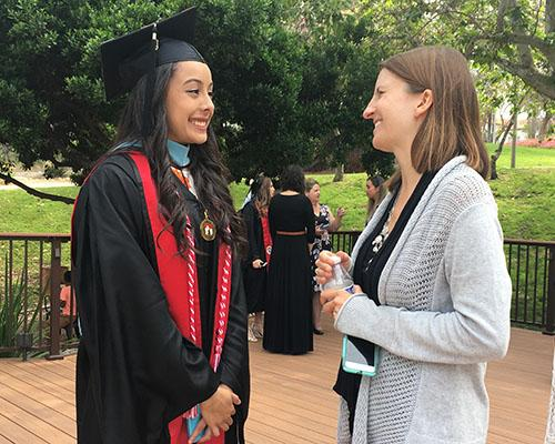 Dr. Sarah Reith connects with one of her graduates