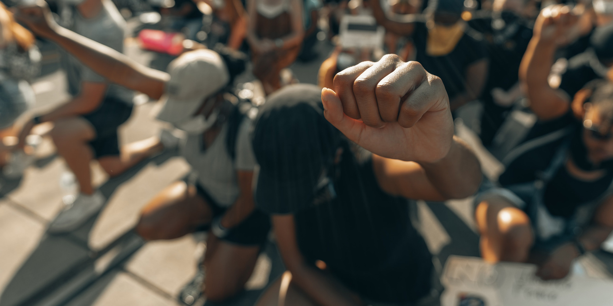 group with fists up in solidarity